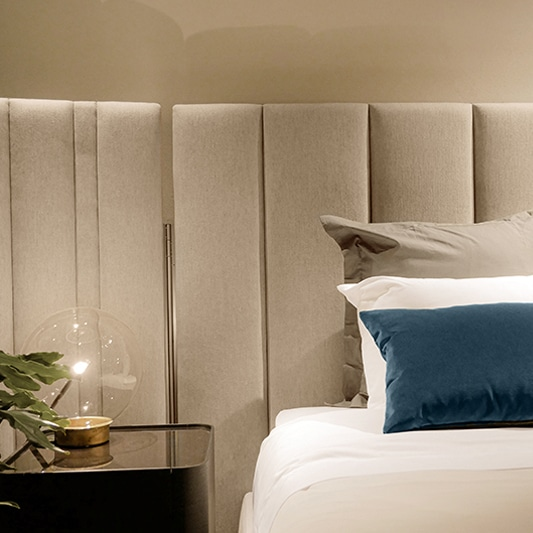 bedside nightstand with large headboard